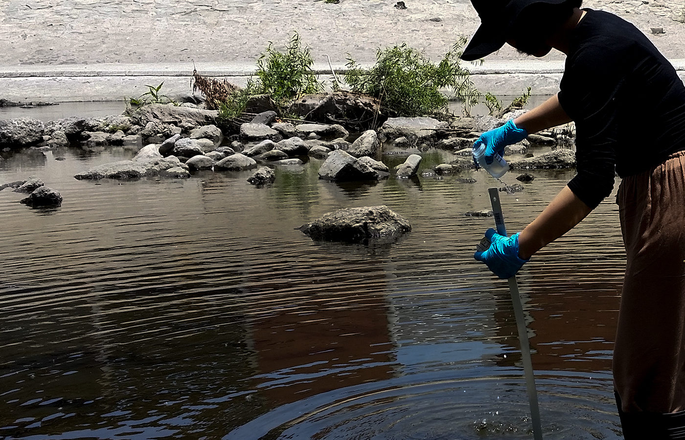 A woman tests the waters in the Los Angeles River.