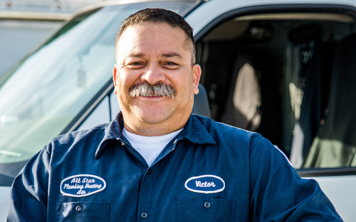 Victor Estrada, owner of All Star Plumbing, in full uniform.