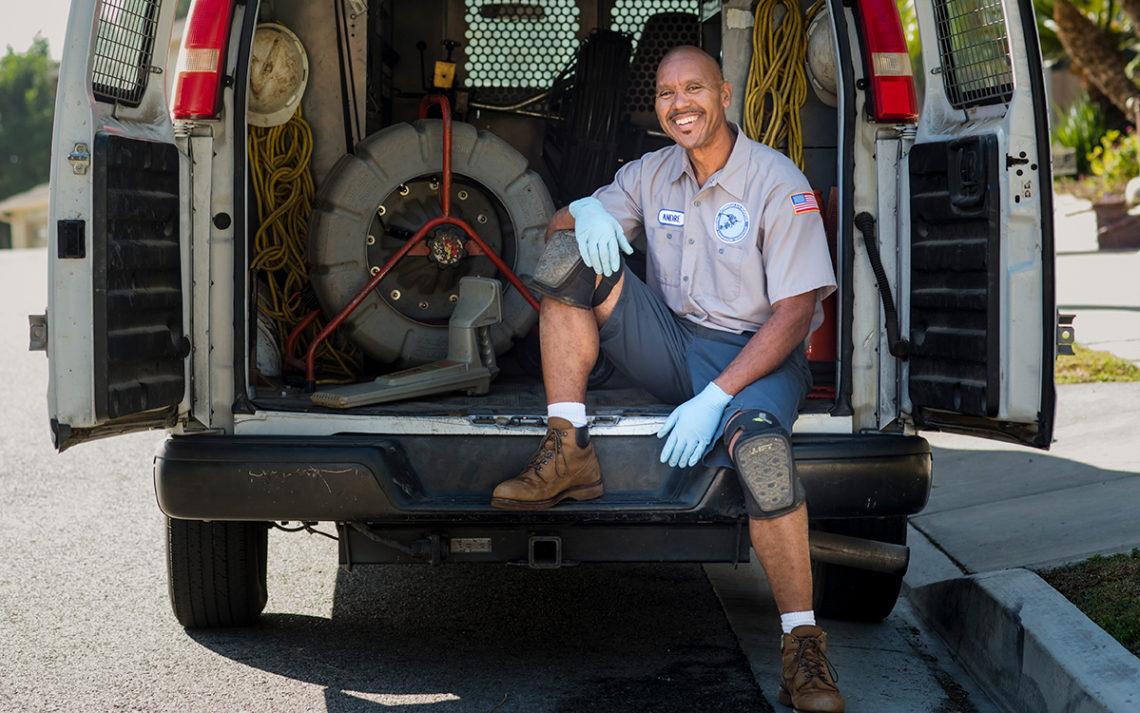 Andre Pierre La France Plumber in his trusty van full of plumbing tools