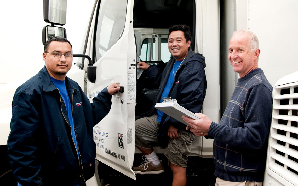 Los Angeles mover Tim Gordon, owner of A Better Way to Move, with two employees next to a moving truck.