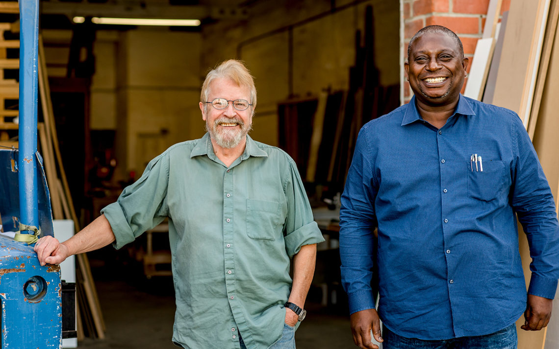 Fred Sefa and Jerry McAffee of Closet Warehouse standing in their workshop.