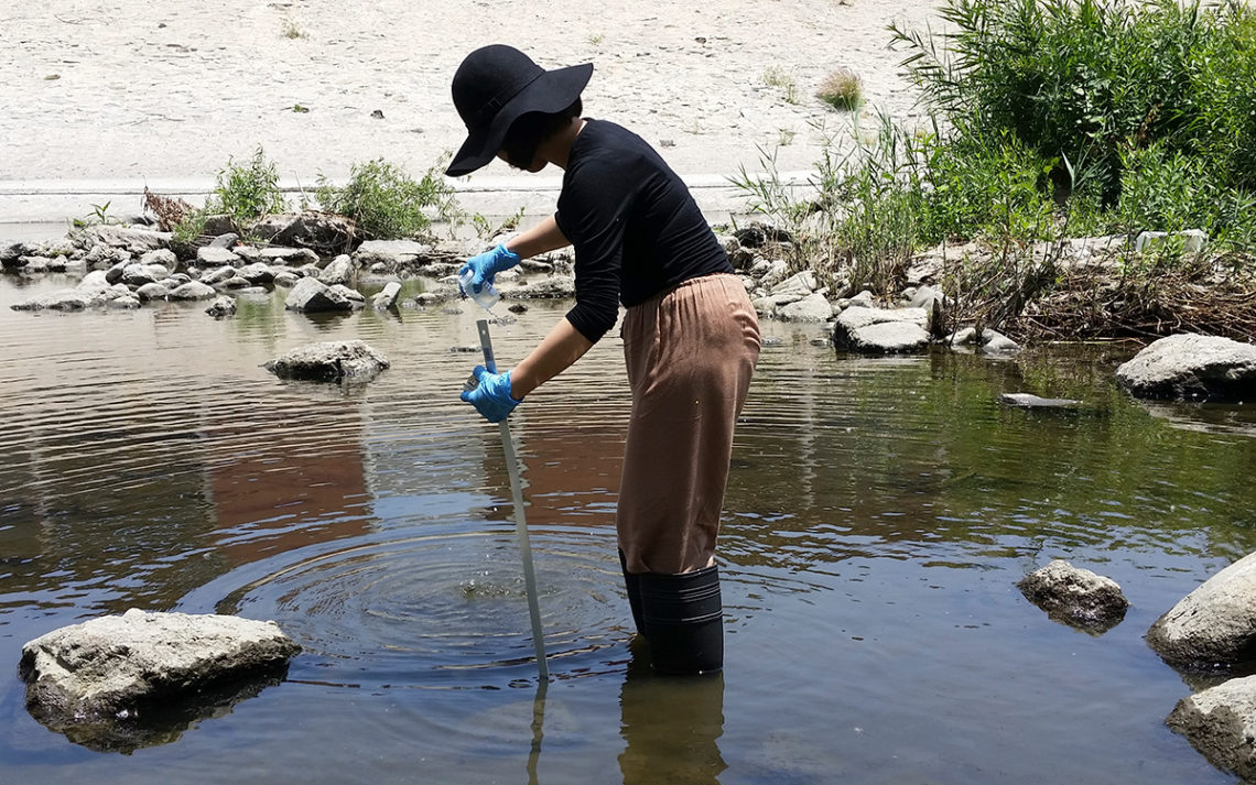 A Council for Watershed Health volunteer tests water