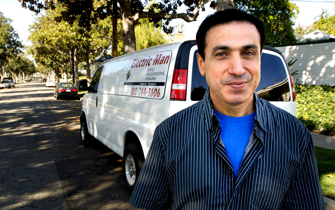Electrician Nick Boghosian, the Electric Man in front of his truck in a Glendale neighborhood.