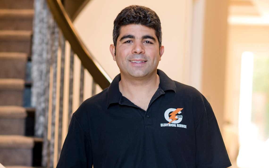 G-Ren Electrical owner Roee Abitboul stands in a customer's home.