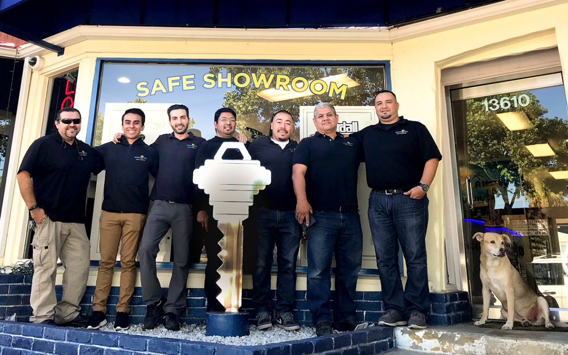 Eli Shirel, owner of Guardian Angel Locksmith, stands in front of his store with an employees