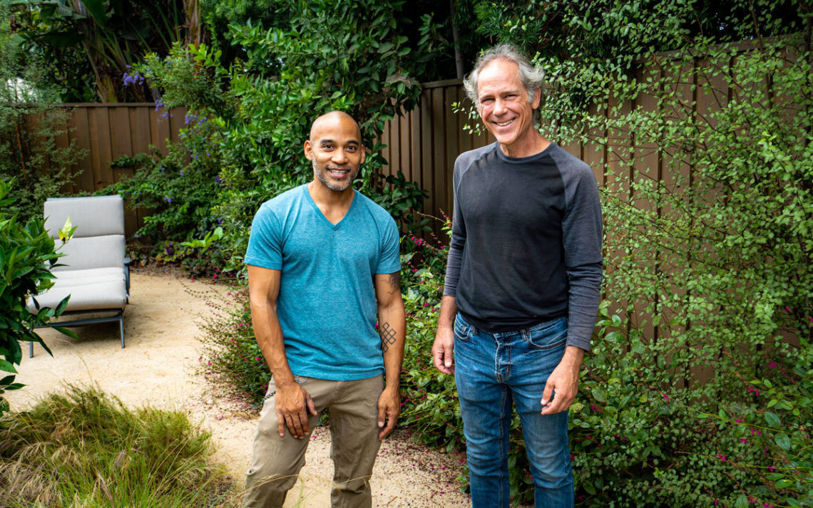 Happy Earth owners Ulysses Aban and Andrew Springer stand in a drought tolerant flowering garden