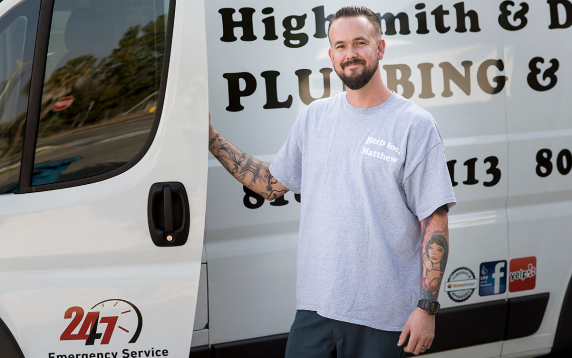 Matthew Highsmith, owner of Highsmith and Daughters Plumbing, stands outside his work truck