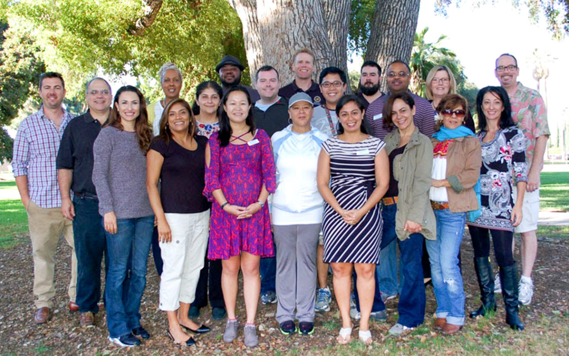 A group of young people in the Leadership Pasadena program pose together.