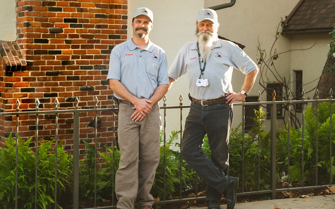 Richard and JR Balliger of Rightway Builders stand in front of a chimney