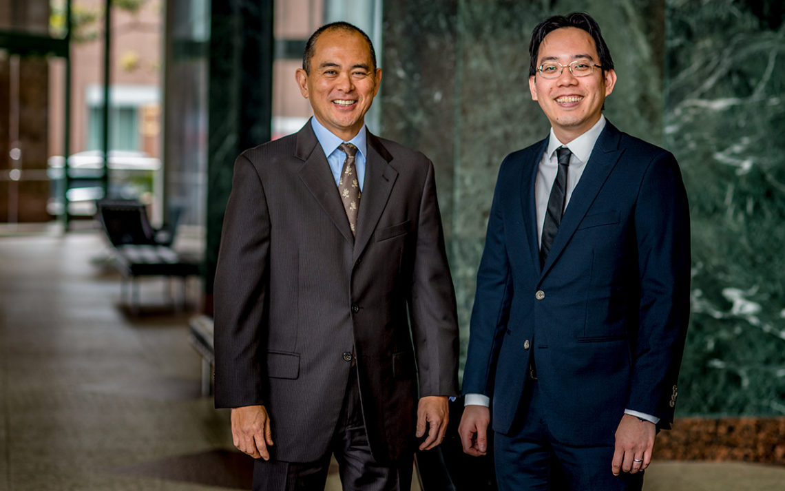 Stephen Shintani, owner of The Shintani Group, with mortgage broker Adam Kam.