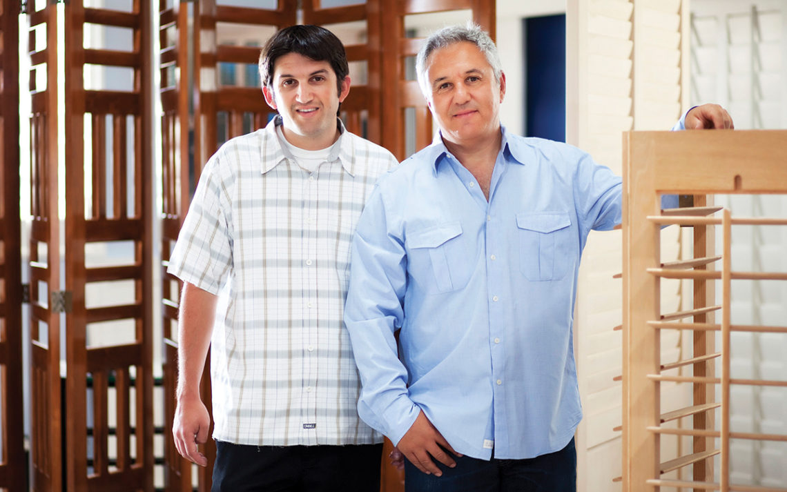 Barry and Claude Sable stand in the showroom of their store, Shutters and More