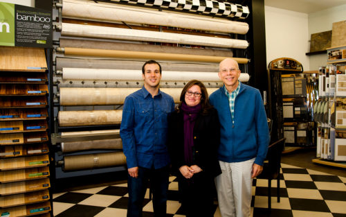 Second generation owner Stan Levy stands in the A-1 Floor Covering showroom with his son and daughter.