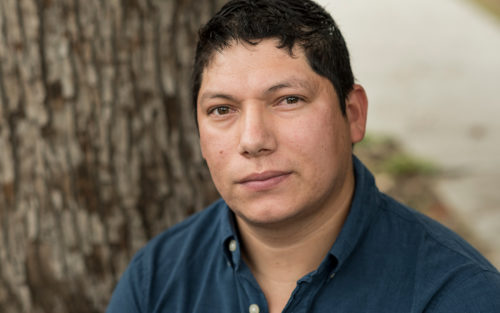 Handyman Alberto Arevalo works in the backyard of a customer.