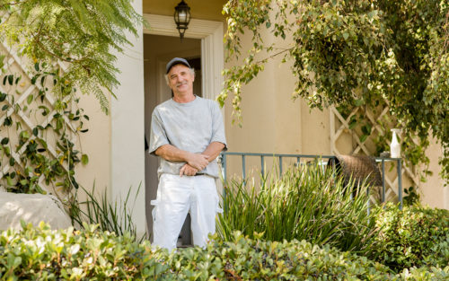 Painting Contractor Alex Rechsteiner stands in front of a customer's house
