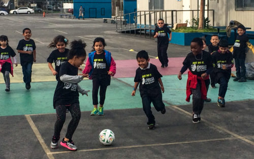 Children play soccer at an America Scores LA event in Los Angeles.