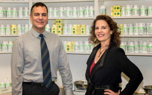Traditional Chinese Medicine practitioners, Aydin Bengisu and Ellen Elphand, in their herb pharmacy.