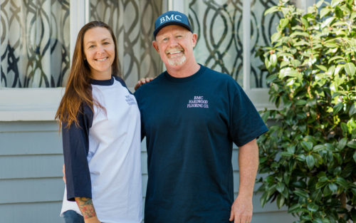 Brian and Michelle Cullen of BMC Hardwood Flooring standing in their front yard