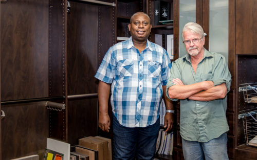 Fred Sefa and Jerry McAffee of Closet Warehouse standing near a bookcase.
