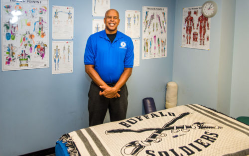 David Cantrell of DC Dynamic Massage shows off his office and therapeutic massage table.