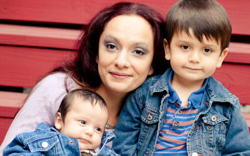 A mother and her two kids who have been helped by Elizabeth House