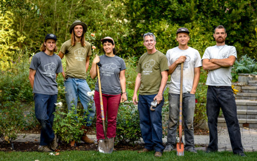 Leigh Jerrard, founder of Greywater Corps, and his workers install a greywater irrigation system.