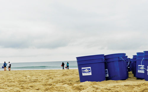 Heal the Bay waste collection bins at a beach clean up event