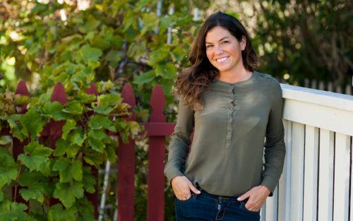 Live Simple owner Jennifer Rybek on a garden deck.