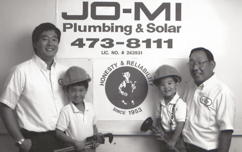 Jo-Mi Plumbing and Solar, Inc's Kelvin Uyeda stand with his father and sons