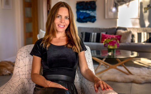 Katherine Carter sits on a chair in her living room.