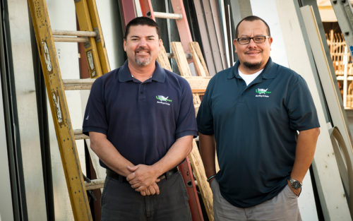 Darren Tangen, owner of Midwest Roofing Co., Inc and his employee on a job site.