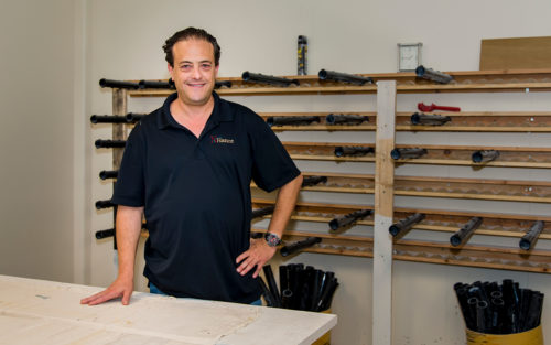 Owner Ronnie Kahan stands in his office