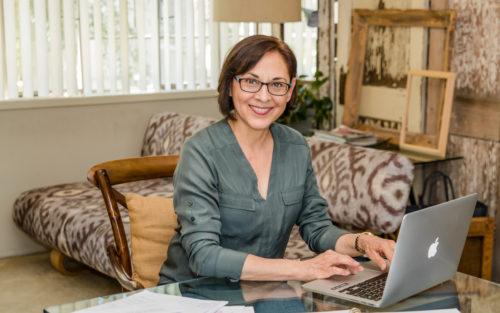Sandra Ateca smiles warmly in her home.