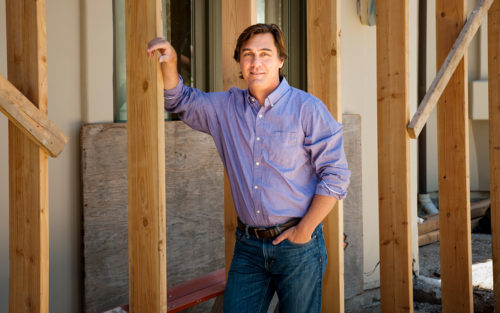 Michael Poloukhine of ReSqaure Architecture smiles on a job site