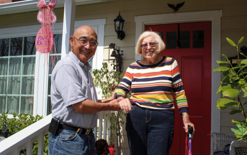 A volunteer from Westside Pacific Village visits an elderly client